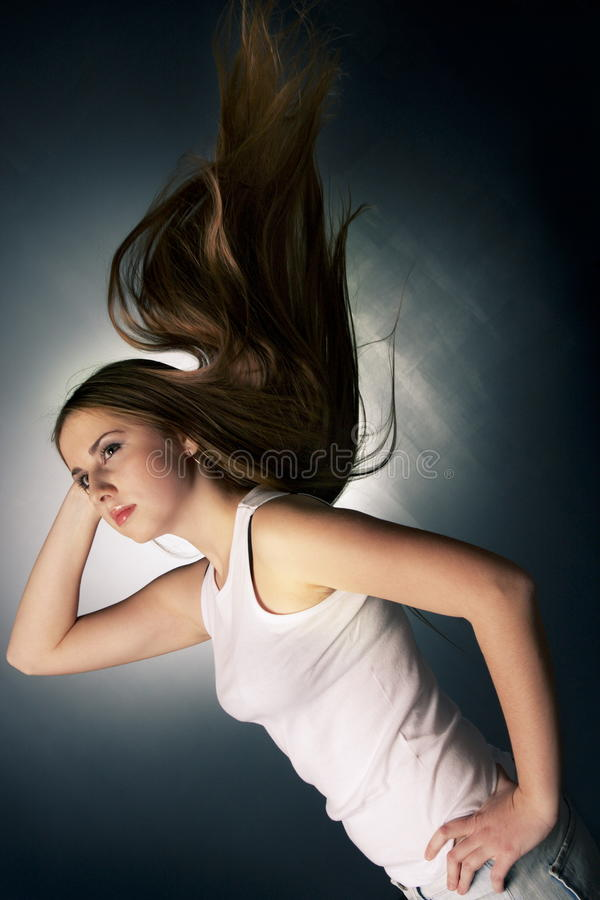 Young girl with flying hairs stock image