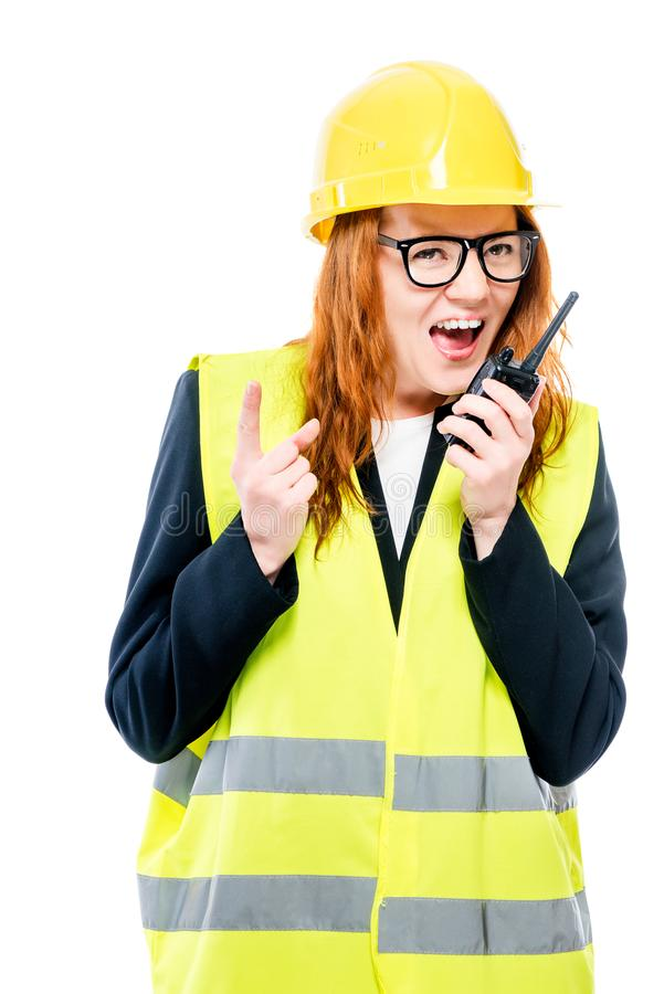 Young girl foreman screaming in walkie-talkie. On white background stock photos