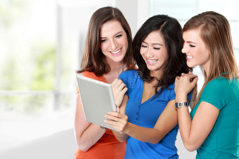 Young girl friend using tablet together stock images