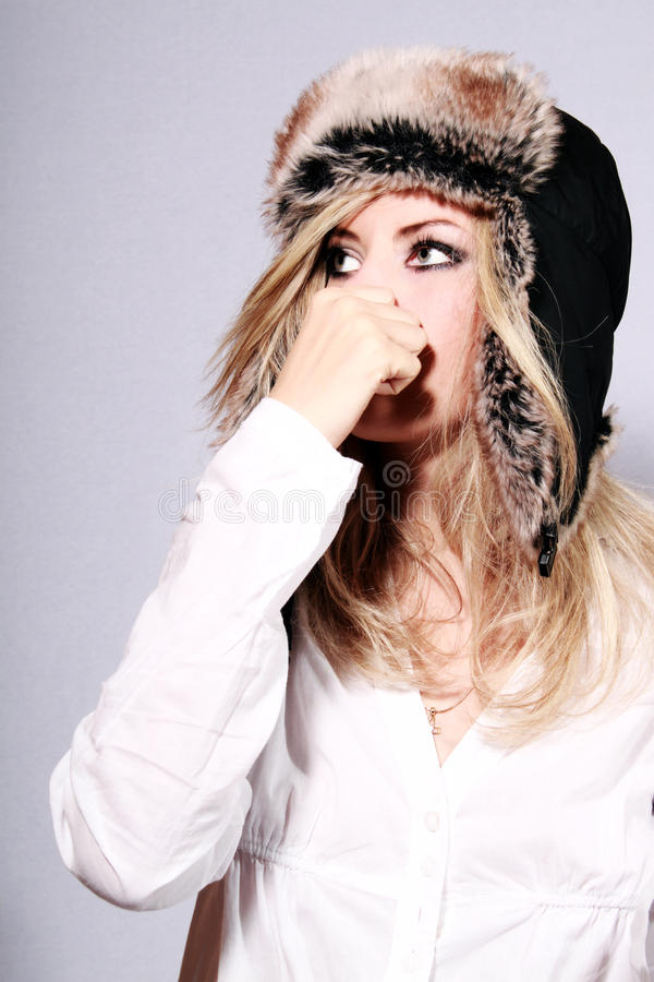 Young girl in a fur hat. Young isolated woman in a fur hat stock photography