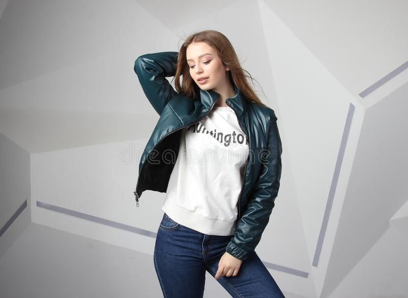 Young girl girl wearing  jacket with area for your logo, mock-up of white women hoodie royalty free stock image