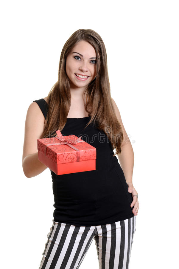 Young girl giving christmas gift royalty free stock photo