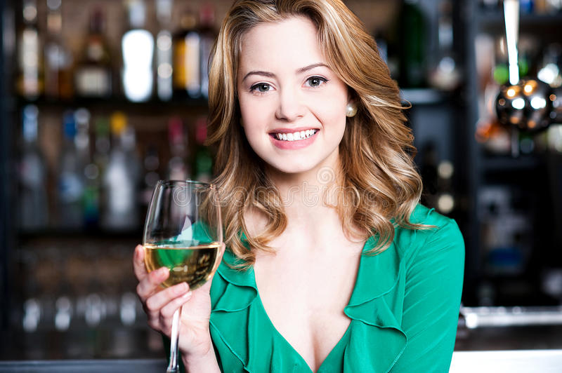 Young girl with a glass of champagne stock photo