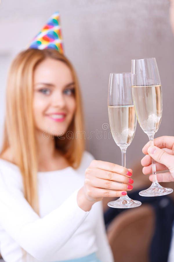 Young girl with glass of champagne royalty free stock photos