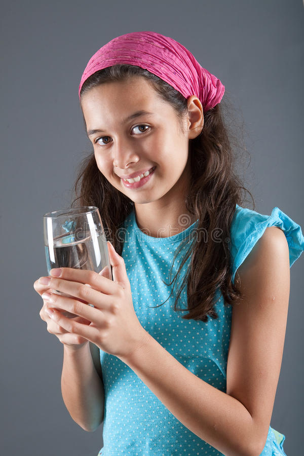 Young girl with a glass of water royalty free stock image