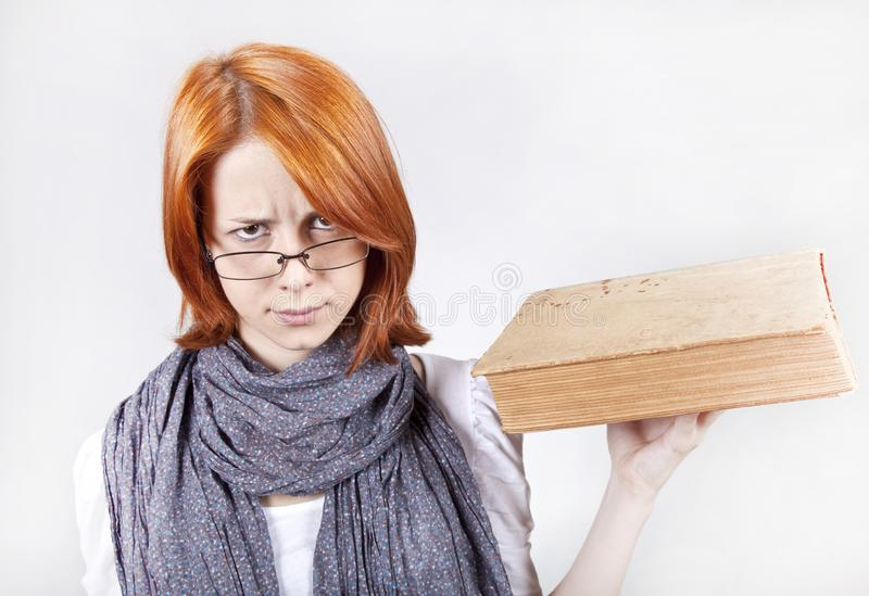 Young girl in glasses with age book.