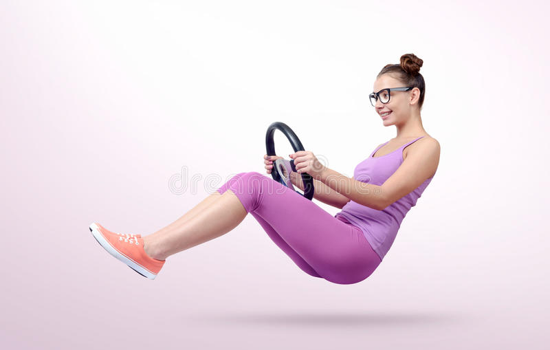 Young girl in glasses driver car with a wheel, auto concept.  stock photos