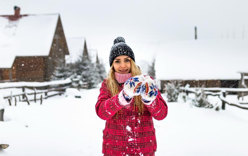 Young girl in glove smiling alone countryside outdoor, snow winter cold weather christmas, outside woman red clothes royalty free stock photo