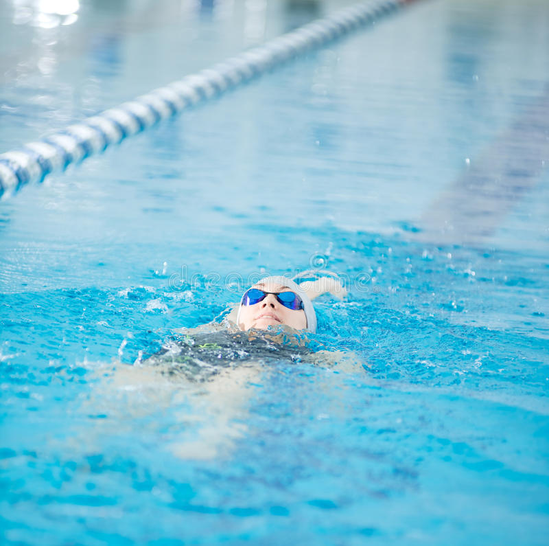 Young Girl In Goggles Swimming Back Crawl Stroke Style Stock Photo
