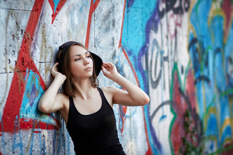 Young girl on graffiti background royalty free stock images