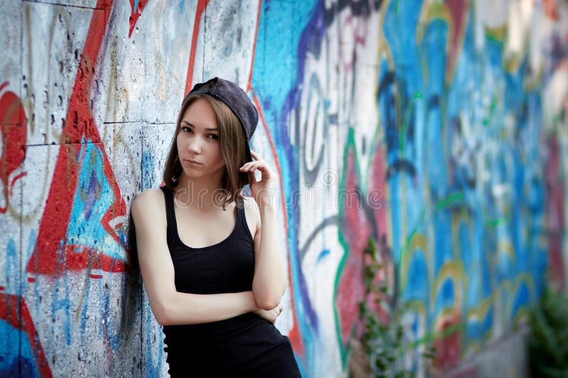 Young girl on graffiti background stock photo