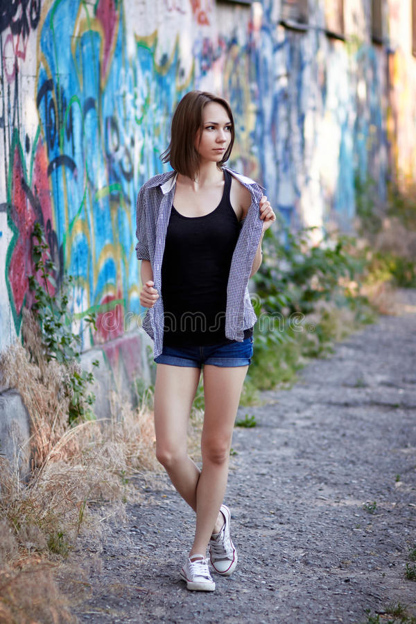 Young girl on graffiti background royalty free stock photos