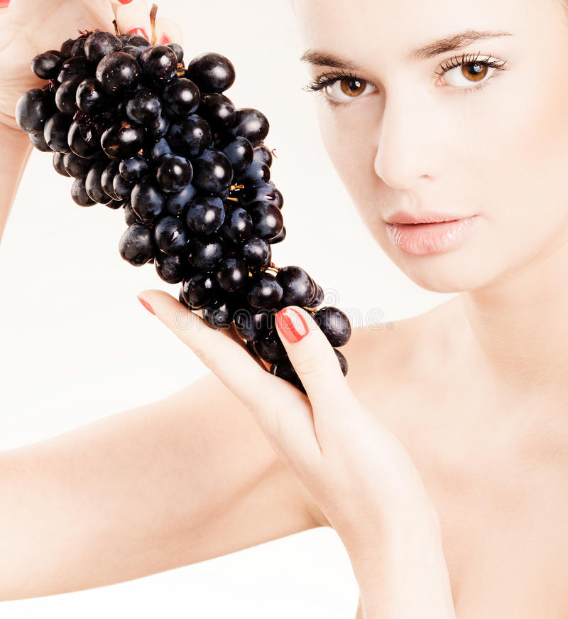 Download Young girl with grapes stock image. Image of skin, look - 13822395