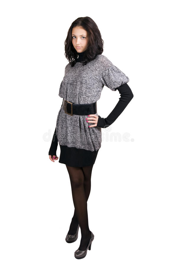 Young girl in a gray dress stock photography