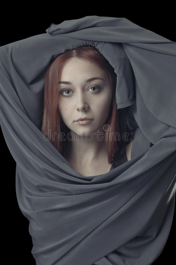 Young Girl With Grey Cloth Royalty Free Stock Photography