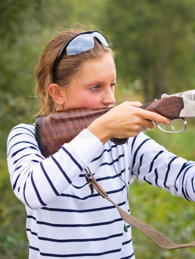 A young girl with a gun for trap shooting royalty free stock photos