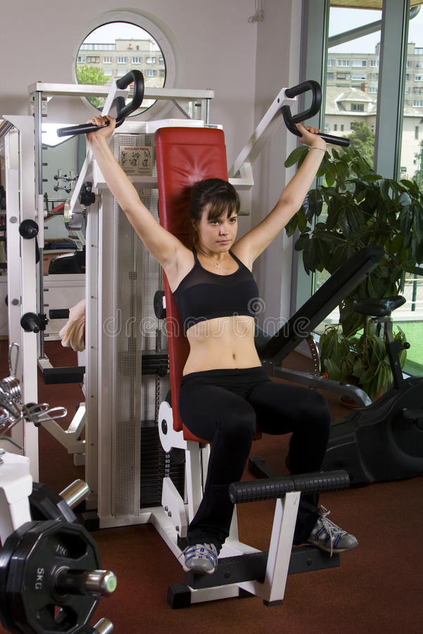 Young girl in the gym stock image