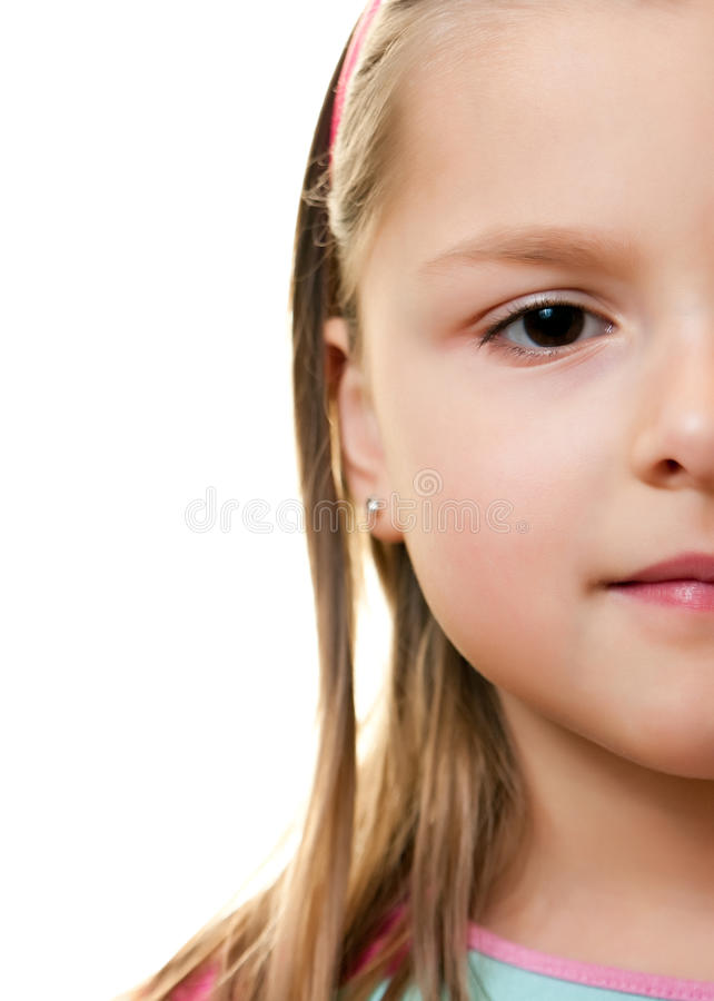 Young girl half face stock photos