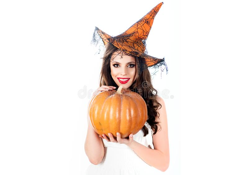 Young girl in Halloween costume. Secrets of magic. Woman witch with pumpkin. Halloween beauty Witch. Trick or treat stock images