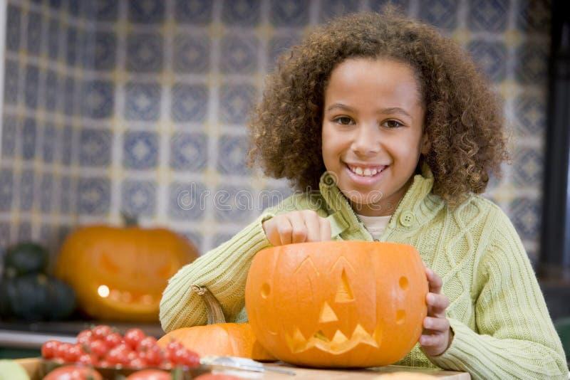 Young girl on Halloween with jack o lantern royalty free stock image