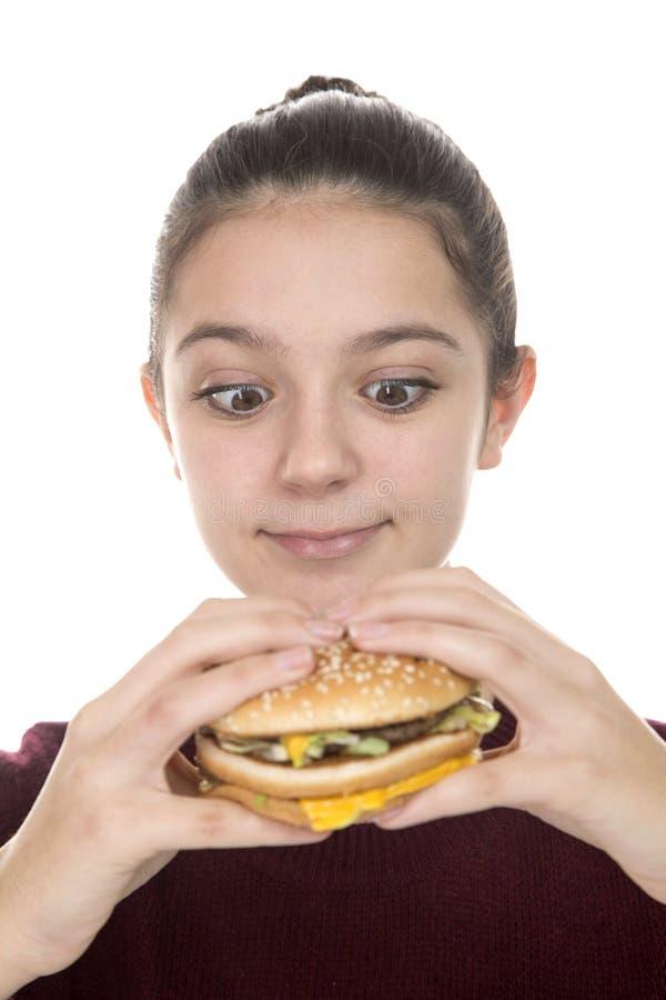 Young Girl with a hamburger royalty free stock image
