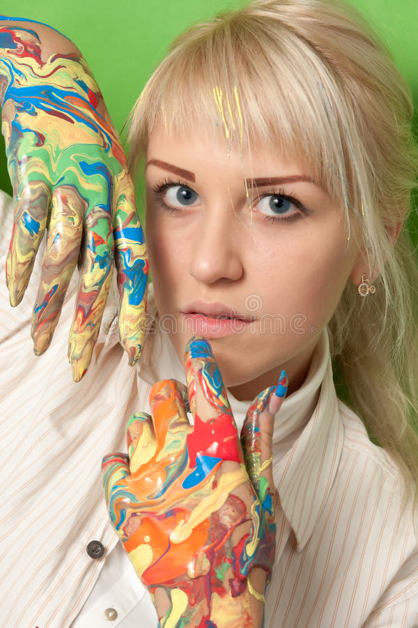 Young girl with hands in fresh paint royalty free stock photos