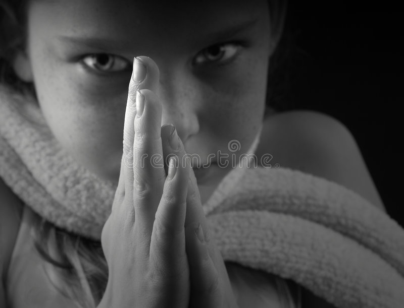 Young Girl With Hands In Prayer Stock Images