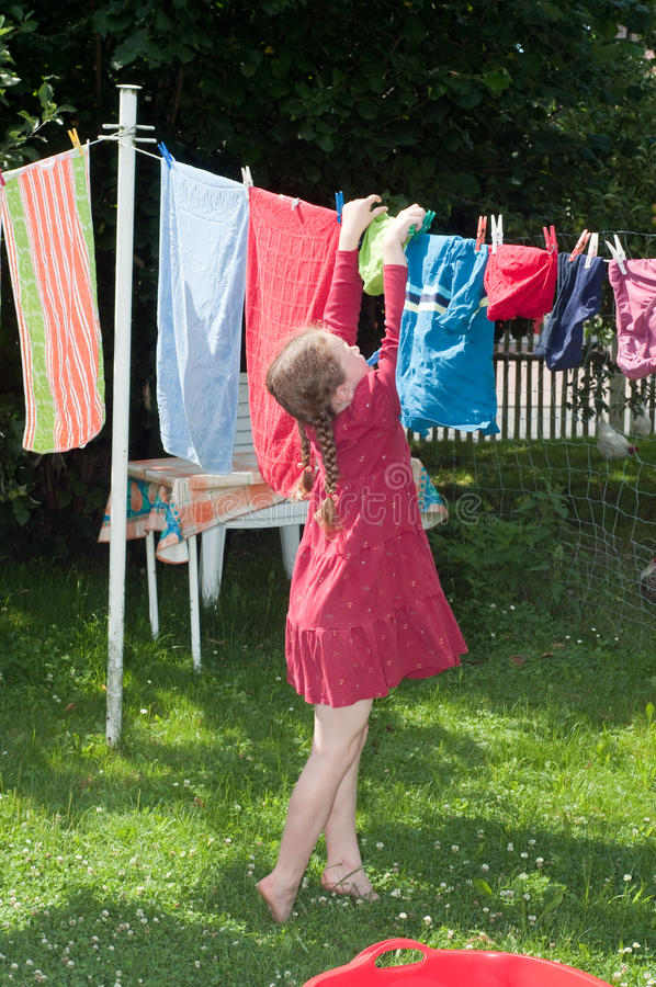 Free Young Girl Hanging Cloth To Dry Stock Photo - 9436960