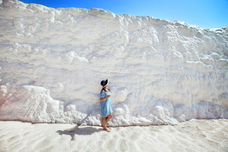 Young girl in hat looking on travertine pools and terraces in Pamukkale. Cotton castle in southwestern Turkey stock image