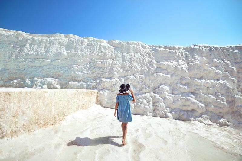 Young girl in hat looking on travertine pools and terraces in Pamukkale. Cotton castle in southwestern Turkey royalty free stock images
