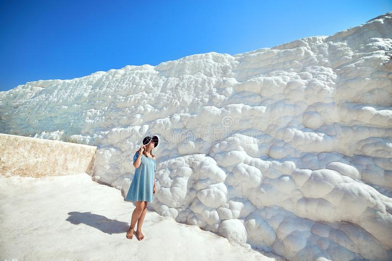 Young girl in hat looking on travertine pools and terraces in Pamukkale. Cotton castle in southwestern Turkey stock photos