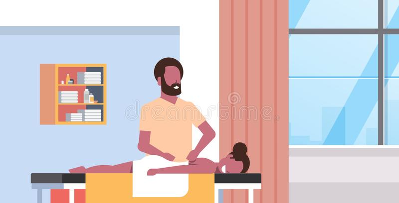 Young girl having back massage african american masseur massaging patient body woman relaxing lying on table luxury spa. Salon interior treatments concept royalty free illustration