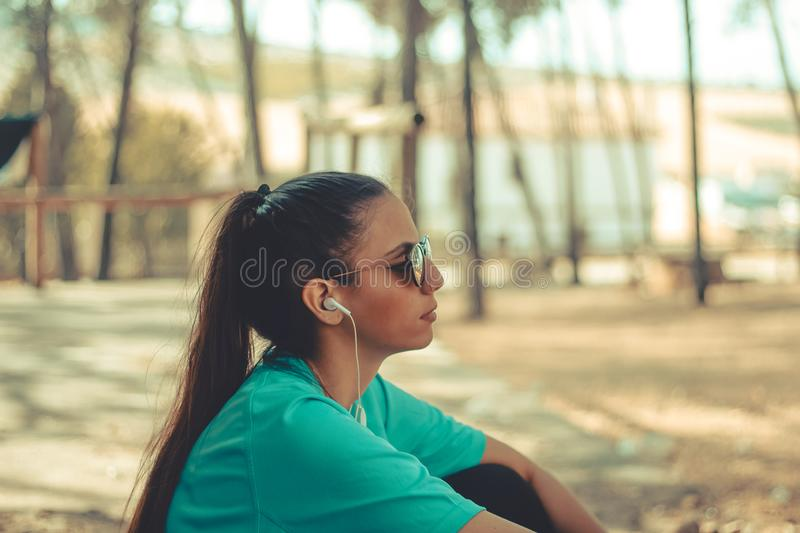Young girl having a break after run stock photos