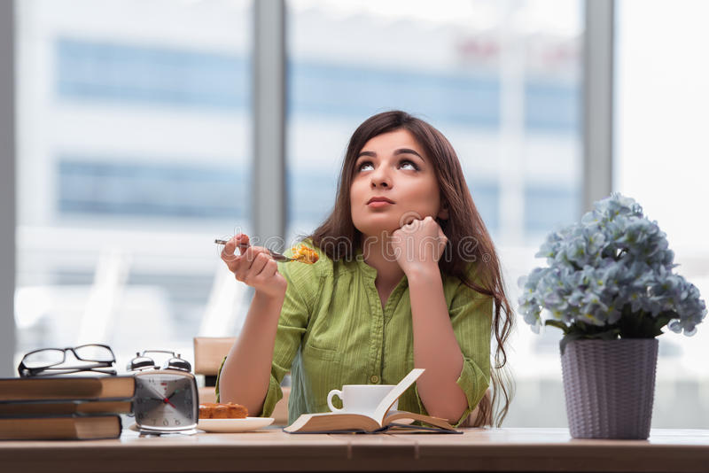 The young girl having breakfast at home royalty free stock photography