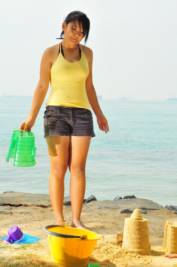 Young Girl Having Fun At The Beach royalty free stock photo