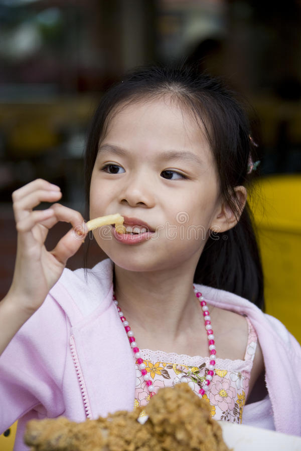 Young Girl Having Fun Eating Stock Image