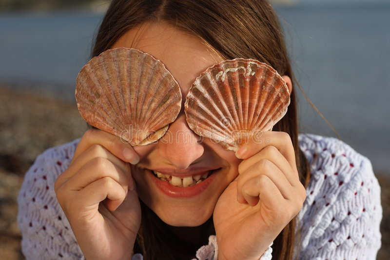 Young girl having fun on holiday. stock photo