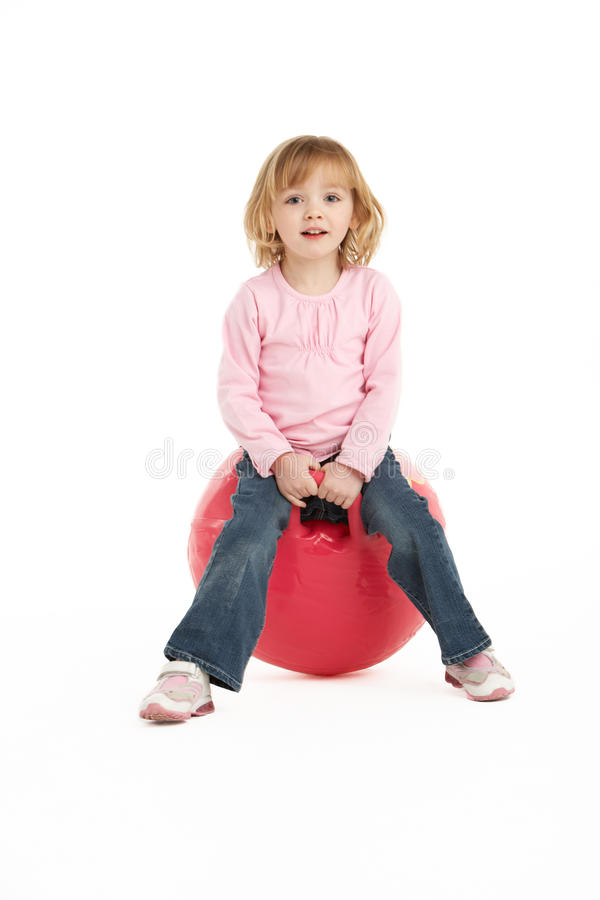 Young Girl Having Fun On Inflatable Hopper stock images