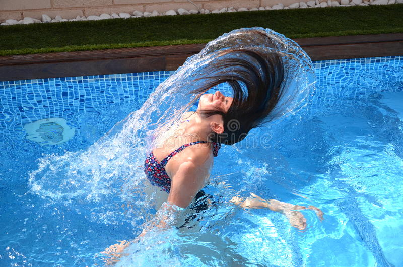 Download Young Girl Is Having Fun In A Swimming Pool Stock Image - Image: 26574793