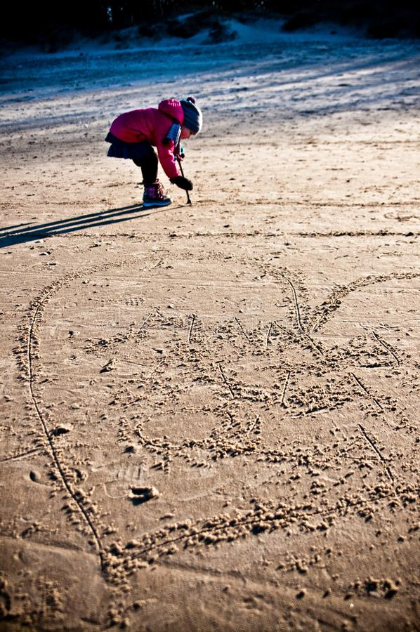 Young girl having fun on winter Baltic beach royalty free stock photography