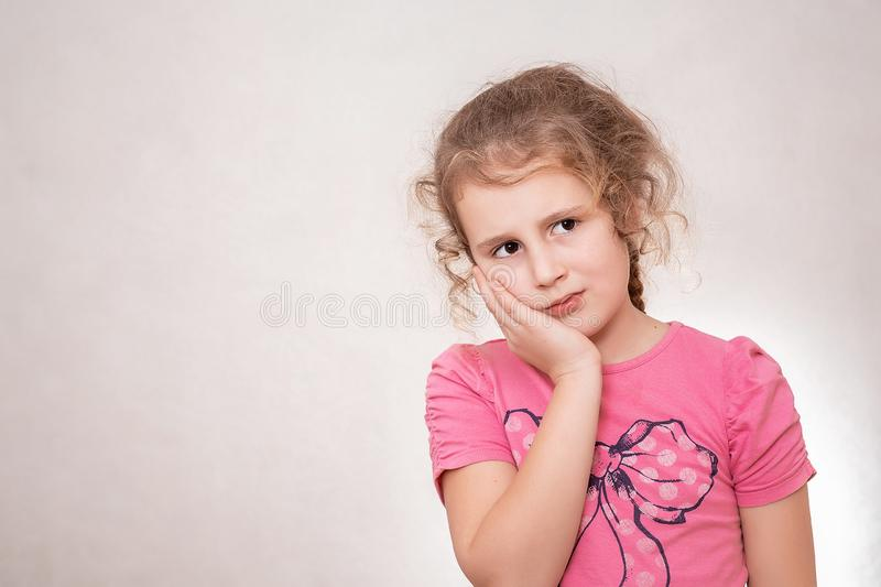 Young girl is having toothache. Pain concept. Young emotional teen. Human emotions, facial expression concept royalty free stock images