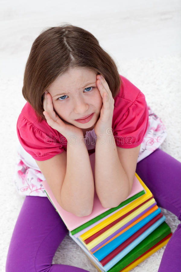 Young girl with headache from too much learning stock photo