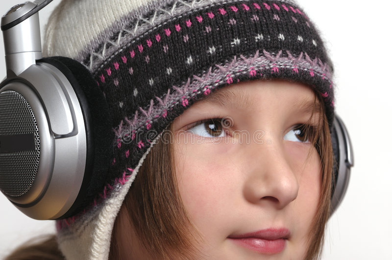 Young girl and headphones royalty free stock photo