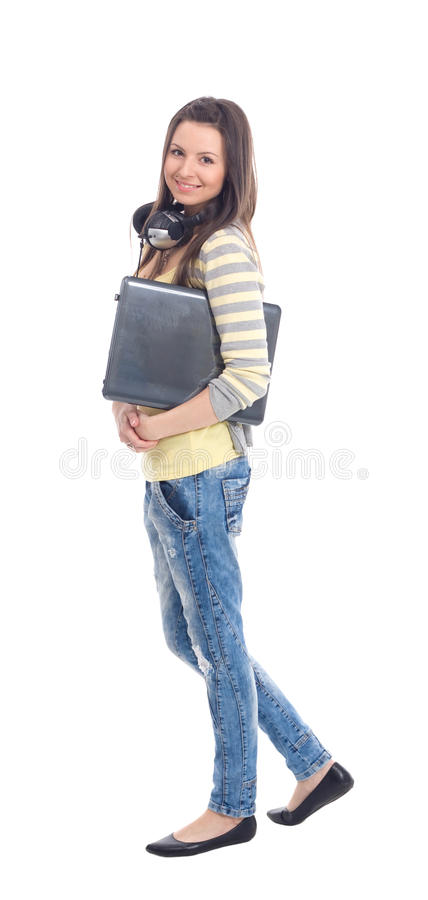 Young girl with headphones and laptop stock photos