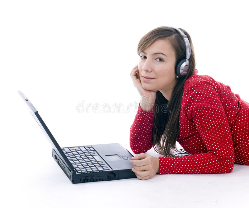 Download Young Girl In Headphones Working On Laptop Stock Photo - Image: 12392822