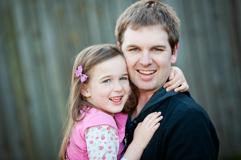 A young girl with her Dad stock photo