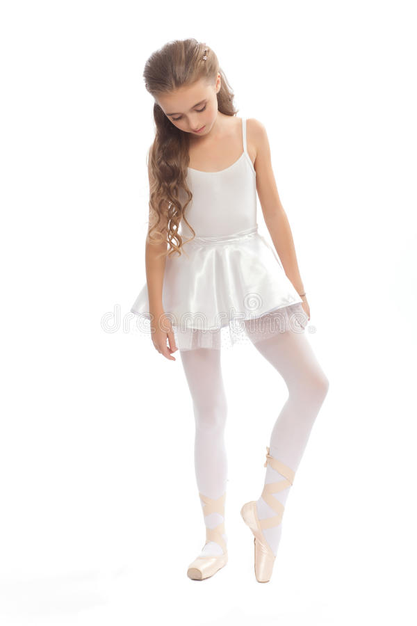Young Girl In Her Dance Clothes Reaching Down To Touch Her Foot Stock Photo - Image -5517