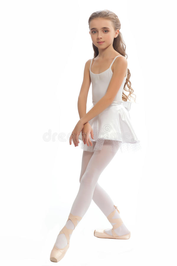 Young Girl In Her Dance Clothes Reaching Down To Touch Her Foot Stock Photo - Image -5759