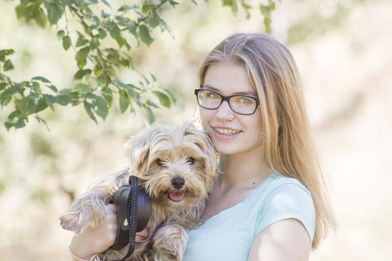 Young girl and her dog stock images