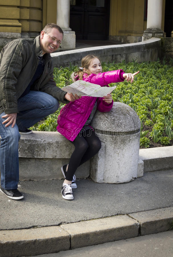 Download Young Girl And Her Father Studying A City Map Stock Image - Image: 28803919